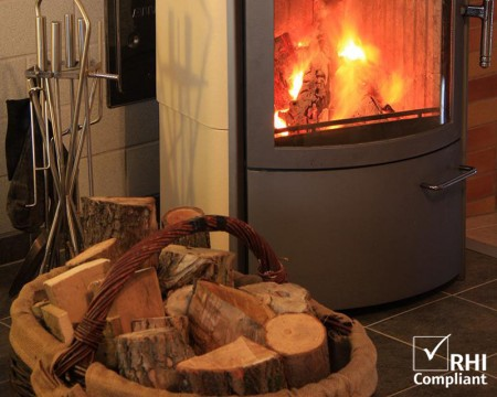 Kiln Dried firewood logs by the fireplace